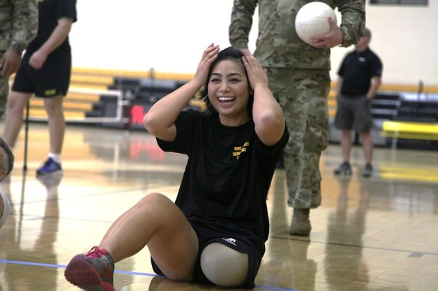 U.S. Army Ret. Mimi Xaysana practices for the sitting volleyball event for the Atlantic/Central Regional Trials at Fort Benning, Georgia on Nov. 30, 2017.