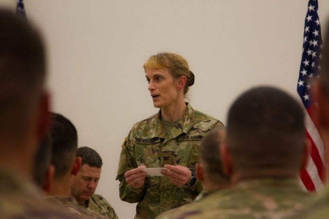 US Army Col. Jean Henderson, commander of the 505th Theatre Tactical Signal Brigade, speaks to her Soldiers of the 319th Expeditionary Signal Battalion, 505th Signal Brigade, 335th Signal Command [Theater], on the various accomplishments they made while deployed at North Fort Hood, Texas, on March 24, 2018. The soldiers of 319 ESB worked for a year to enhance communications and train alongside America's Allies across US Africa Command. (US Army photo taken by Spc. Nicholas Vidro, 7th Mobile Public Affairs Detachment.)