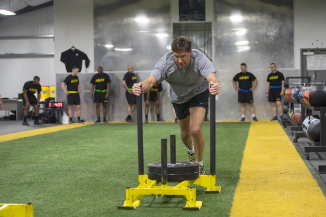 Secretary of the Army Mark T. Esper takes part in a morning PT session with Soldiers from 2nd Brigade, 22nd Infantry Regiment, 1st Brigade Combat Team during a visit to Fort Drum, New York, Mar. 29, 2018.