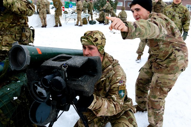 U.K. Cpl. Nathan Hollinshead (left), an infantryman with the Royal 22nd Regiment, and U.S. Army Pfc. Ryan Oliver (right), a wheeled vehicle mechanic with the 82nd Brigade Engineer Battalion, 2nd Armored Brigade Combat Team, 1st Infantry Division, practice using a Javelin Weapon Testing System during a multinational cross-training session in Tapa, Estonia, March 9, 2018 as part of a rapid response readiness exercise in support of Atlantic Resolve.