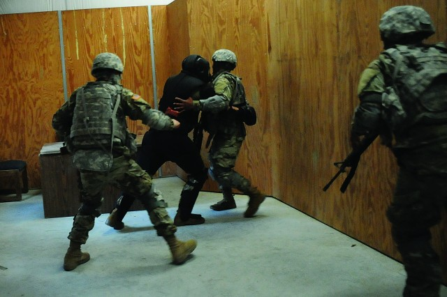 The suspect, surrounded, launches himself toward a Soldiers as fellow teammates close in.