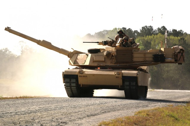 A M1A1-SA Abrams belonging to D Troop, 6th Squadron, 8th Cavalry Regiment, 2nd Armored Brigade Combat Team, 3rd Infantry Division, moves along the boundary road in route to their battle position during the Troop gunnery qualification, March 29 at Fort Stewart, Ga. This marks the first time since 2ABCT started their conversion from light to armor last fall that tank crews have participated in gunnery. (U.S. Army photo by Staff Sgt. Nathan C. Berry/released)