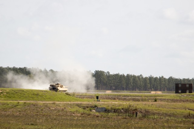 A M1A1-SA Abrams from D Troop, 6th Squadron, 8th Cavalry Regiment, 2nd Armored Brigade Combat Team, 3rd Infantry Division, fires a main gun round at enemy target during the troop gunnery qualification, March 29 at Fort Stewart, Ga. This marks the first time since 2ABCT started their conversion from light to armor last fall that tank crews have participated in gunnery. (U.S. Army photo by Staff Sgt. Nathan C. Berry/released)