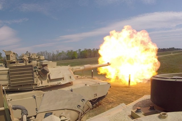 Troopers with Delta Tank Company, 6th Squadron, 8th Cavalry Regiment, 2nd Armored Brigade Combat Team, 3rd Infantry Division, fire the main gun round at a target during unit gunnery, March 29 at Fort Stewart, Ga. This gunnery marked the first time 2nd ABCT Troopers fired their newly received M1A1-SA Abrams Tanks since the brigade converted from a light to an armored brigade combat team. (Courtesy Photo)