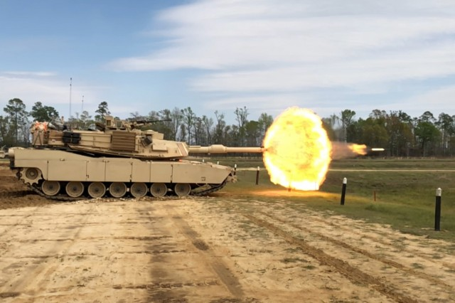Troopers with Delta Tank Company, 6th Squadron, 8th Cavalry Regiment, 2nd Armored Brigade Combat Team, 3rd Infantry Division, fire their main gun round at a target during unit gunnery, March 29 at Fort Stewart, Ga. This gunnery marked the first time 2nd ABCT Troopers fired their newly received M1A1-SA Abrams Tanks since the brigade converted from a light to an armored brigade combat team. (U.S. Army photo by Spc. Leo Jenkins/released)