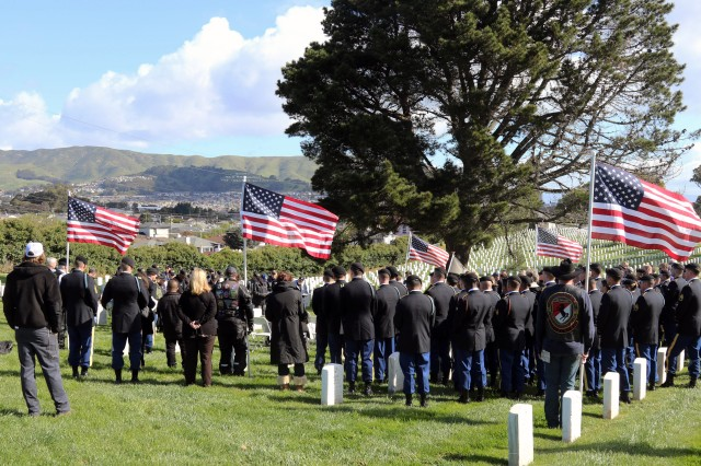 """Soldiers of 1st Brigade Combat Team, 101st Airborne Division (Air Assault), join veterans and citizens at the Golden Gate National Ceremony, during a remembrance ceremony, for SGT Joe Artavia, a 101st Abn. Div. veteran, March 25, 2018 in San Bruno, California. Artavia was killed in action during the Vietnam War and in the last 50 years, since his death, his sister has been devoted to connecting cities who want to """"adopt"""" military units."""