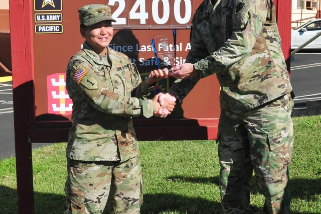 Sgt. Ann Recinto, a unit supply specialist with the 303rd Ordnance Battalion (EOD), receives a Safety Excellence award from Col. Douglas Vallejo, deputy commander of the 8th Theater Sustainment Command, March 29 at Fort Shafter. Recinto received the award after personally saving more than a dozen Soldiers from drowning while working as a lifeguard during the 2017 German Armed Forces Proficiency Badge qualification at Schofield Barracks. With Recinto's help, there were no accidents or injuries during the rigorous swim portion of the GAFPB qualification which hosted more than 220 Soldiers from across the U.S. Army Hawaii footprint. (U.S. Army photo by Sgt. 1st Class Michael Behlin)