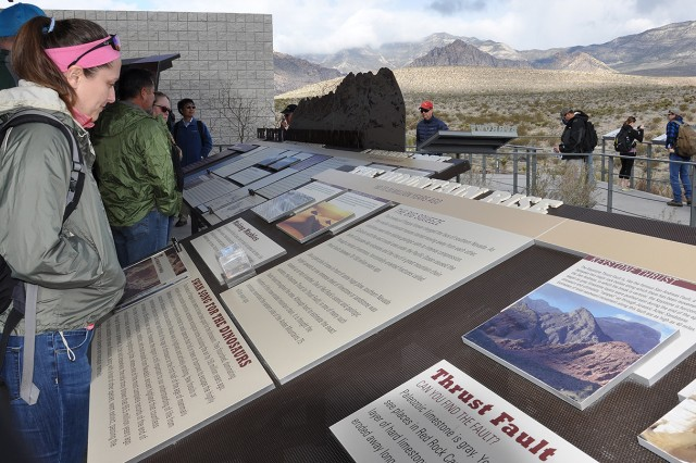 Heather Hickerson, a geologist with the U.S. Army Corps of Engineers New Orleans District, checks out information at the Red Rock Canyon Visitor's Center before taking part in a paleoflood exercise and hike to the Keystone Thrust Fault March 15 at the Red Rock Canyon National Conservation Area near Las Vegas.