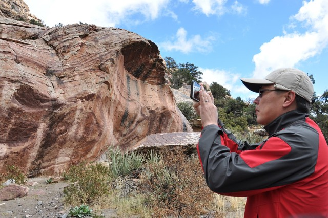 A U.S. Army Corps of Engineers geologist takes a picture of clay imprints on a canyon wall -- a predictor indicating that previous pre-historic flood levels had not risen to that height in hundreds, or perhaps, thousands of years -- during a paleoflood exercise March 15 at the Red Rock Canyon National Conservation Area near Las Vegas.