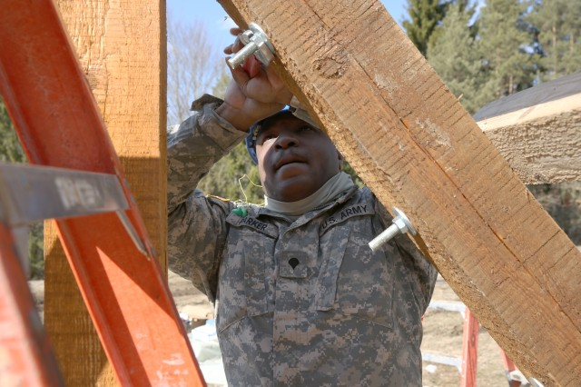 A U.S. Army Soldier with the 859th Engineer Company (Vertical), Mississippi Army National Guard, works on a portion of an obstacle course the unit is building at the Joint Multinational Readiness Center's Hohenfels Training Area, Hohenfels, Germany, March 21, 2018. The Army National Guard unit is conducting their annual training in Germany, while helping U.S. Army Europe's premiere Combat Training Center with some much needed projects throughout the training area.