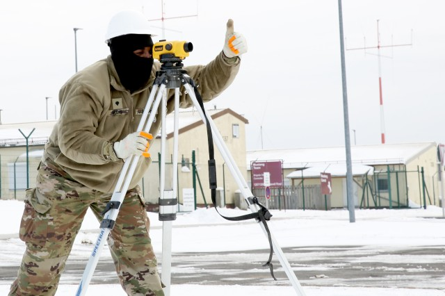 A U.S. Army Soldier with the 859th Engineer Company (Vertical), Mississippi Army National Guard, uses a surveying tool as the unit prepares the ground for a concrete slab they'll soon pour, which will become the foundation for a gazeebo they are building at the Joint Multinational Readiness Center's Hohenfels Training Area, Hohenfels, Germany, March 19, 2018. The Army National Guard unit is conducting its annual training in Germany, while helping U.S. Army Europe's premiere Combat Training Center with some much needed projects throughout the training area.