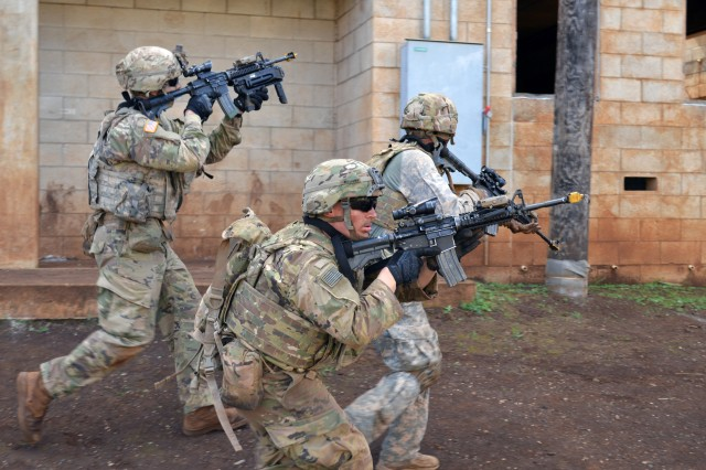 Infantrymen assigned to 2nd Battalion, 35th Infantry Regiment, 3rd Brigade Combat Team, 25th Infantry Division, scan and rush to their objective during squad room-clearing training at Schofield Barracks, Hawaii, on Dec. 5, 2017. Soldiers of the 3rd Special Forces Group (Airborne) recently underwent similar training as part of a combatives training program.