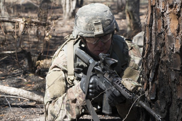 Spc. Nolan Queen with Charlie Company, 2nd Combined Arms Battalion, 69th Armor Regiment, 2nd Armored Brigade Combat Team, 3rd Infantry Division, pulls security during a platoon live-fire exercise at Fort Stewart, Ga., Mar. 14, 2018. The platoon exercise was held to improve the readiness, maneuverability, and weapons proficiency of the company. This company is the only infantry company in the battalion. While crewman field armored vehicles, dismounted soldiers train on light infantry tactics. (U.S. Army photo by Spc. Jonathan Wallace/Released)