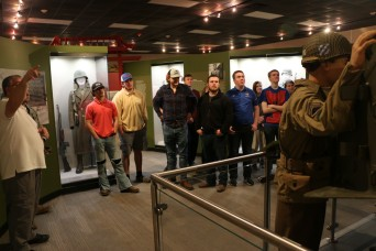 Georgia High School Tech students, look on at the WWII era exhibit at the 3rd Infantry Division and Fort Stewart Museum during a tour of Fort Stewart, Ga. on Feb. 15. The Georgia High School High Tech Program is a community-based program providing yo...