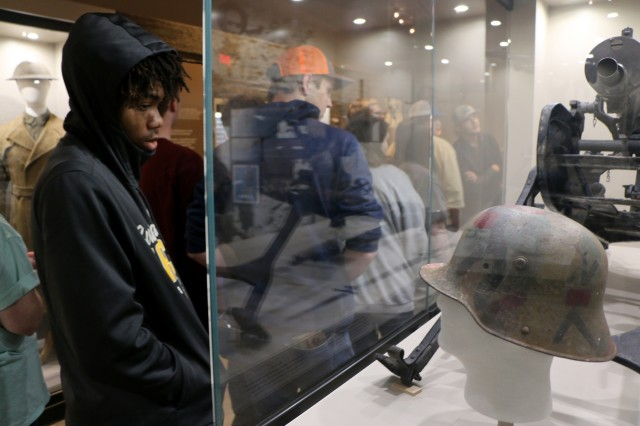Georgia High School Tech student, Travion Johnson, looks at a WWI era helmet at the 3rd Infantry Division and Fort Stewart Museum during a tour of Fort Stewart, Ga. on Feb. 15.The Georgia High School High Tech Program is a community-based program providing youth with disabilities a link to academic and career development experiences, such as military service. The tour was hosted by Soldiers of 2nd Battalion, 69th Armor Regiment, 2nd Armored Brigade Combat Team, 3rd Infantry Division and  included a static display of military equipment, a visit to Warriors Walk, lunch with Soldiers and a visit to the museum. (U.S. Army photo by Spc. Jonathan Wallace/Released)