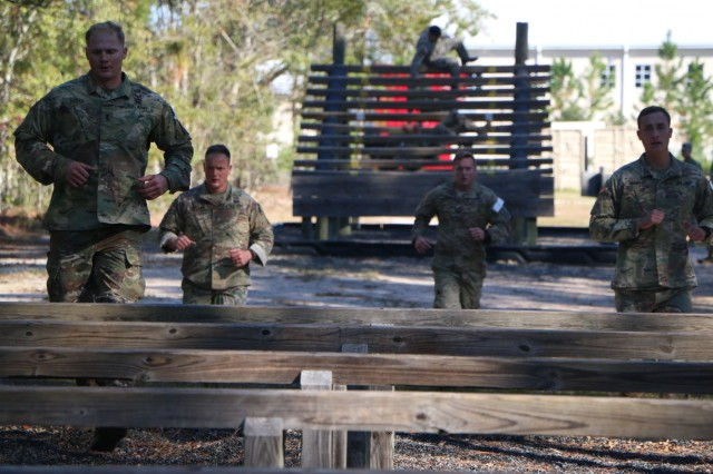 From left, 1st Lt. Stephen Lloyd, 1st Lt. George Sandelbach, Capt. Ryan Bell, and 1st Lt. Patrick Murray with 2nd Combined Arms Battalion, 69th Armor Regiment, 2nd Armored Brigade Combat Team, 3rd Infantry Division, run run between obstacles as part of the 3rd Annual Thornsbury Challenge during Marne Week, Nov. 15, 2017 at Fort Stewart, Ga. The challenge, named in honor of Sgt. 1st Class Duane A. Thornsbury, is composed of an obstacle course, a memory test, a ruck march, a casualty evacuation, and a run. Thornsbury gave his life in defense of his country while assigned to 2nd Battalion, 10th Special Forces Group on Sept. 12, 2009 in Baghdad, Iraq.  Marne Week is a celebration for Soldiers to compete in team sports and recreational group activities while honoring the division's service to the nation. This month marks the centennial anniversary of the Marne Division. Born out of World War I, the division has answered the nation's call for 100 years. (U.S. Army photo by Spc. Jonathan Wallace / Released)