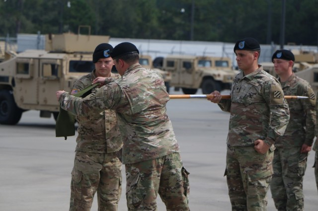 "Soldiers of Dragon Company, 1st Battalion 30th Infantry Regiment, 3rd Infantry Division case their company guidon during a ceremony at Fort Stewart, Ga., Sept. 21, 2017. The casing is part of a larger effort to convert the entire Spartan Brigade from a light infantry to an armored brigade combat team. Next month, the ""Battle Boar"" Battalion will convert from an infantry battalion to a combined arms battalion. The unit has successfully deployed in support of full spectrum combat operations since World War I and most recently deployed in support of Operation Enduring Freedom."