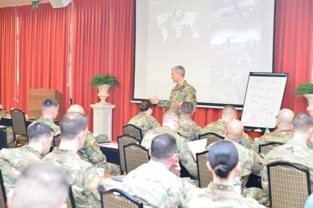 Col. David Conkle, commander, 207th Military Intelligence Brigade (Theater), addresses brigade personnel at a Senior Leader Professional Development session during day two of Lightning Week, at the Golden Lion Club, Caserma Ederle, Italy, March 13. Lightning Week is a week-long series of organizational development events to foster discussions amongst leaders' to improve brigade priorities and readiness.