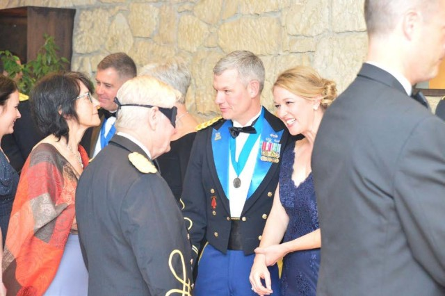 Col. David Conkle (center), commander, 207th Military Intelligence Brigade (Theater), and his wife, Heather, welcome guests in the receiving line at the 2nd Annual 207th Military Intelligence Brigade Ball at the Hotel Villa Michelangelo in Arcugnano, Italy, March 15.