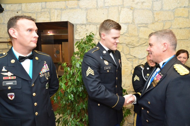 Maj. Gen. Christopher Ballard (right), commanding general, U.S. Army Intelligence and Security Command (INSCOM), greets 207th Military Intelligence Brigade personnel prior to the start of the 2nd Annual 207th Military Intelligence Brigade Ball at the Hotel Villa Michelangelo in Arcugnano, Italy, March 15.