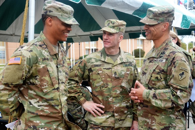 Pfc. Isiah Sharp, 116th Military Intelligence Brigade, shares a laugh with Sgt. Maj. of the Army Daniel A. Dailey and Brig. Gen. Robert L. Edmonson II, Chief of Signal and U.S. Army Signal School commandant, prior to Fort Gordon's Sexual Assault Awareness and Prevention month opening ceremony held on March 29.