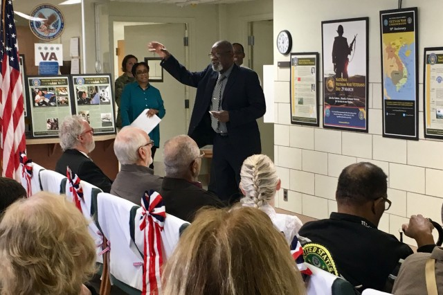 Vietnam War veteran and guest speaker, retired Sgt. Maj. Alvin Colvin, talks about his service assigned to a U.S. Army Air Ambulance Company in Vietnam at the National Vietnam Veterans Day commemoration at the Fort Campbell Integrated Disability Evaluation System clinic March 29. Blanchfield Army Community Hospital and Veterans Affairs staff the IDES clinic organized the event honoring the 9 million men and women who served on active duty in the U.S. Armed Forces during the Vietnam War Era from Nov. 1, 1955 to May 15, 1975. U.S. Army photo by Laura Boyd.