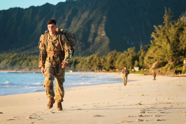 Soldiers with the Sensor Management Cell assigned to the 94th Army Air and Missile Defense Command, perform a tactical beach road march on Bellows Air Force Station, Waimanalo, Hawaii, on March 27, 2018. The weeklong competition tested the Soldiers during individual and team competitive events. (U.S. Army photo by Capt. Adan Cazarez)