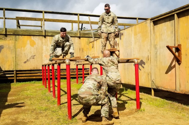 Soldiers with the Sensor Management Cell assigned to the 94th Army Air and Missile Defense Command, participate in the Leadership Reaction Course (LRC) as part of the Best Crew Competition on Schofield Barracks, Hawaii, on March 26, 2018. (U.S. Army photo by Sgt. 1st Class Israel Gonzalez)
