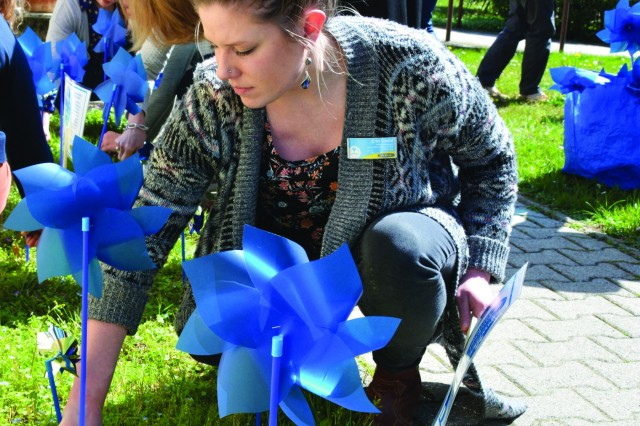 "CASERMA EDERLE, Italy - Erin K. Caula of Greensboro, North Carolina, victim advocate coordinator, Family Advocacy Program here, helped other members of the ACS team ""plant"" a pinwheel garden April 2 at Bldg. 108. The pinwheels serve as a visual reminder that all children deserve a healthy, happy and carefree childhood - free from abuse and neglect. April is Child Abuse Prevention Month."