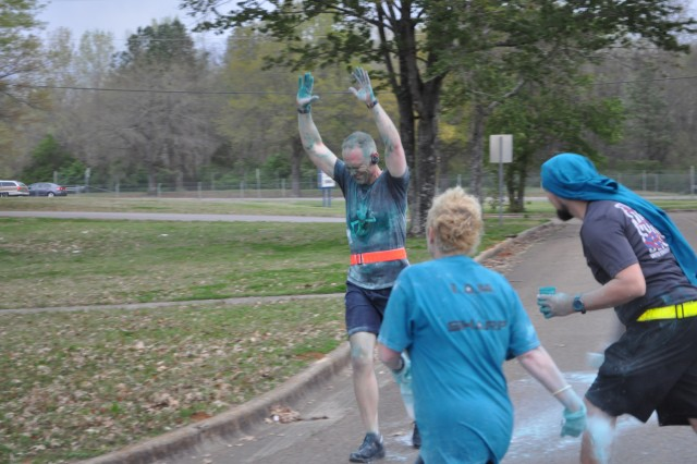Toby Davis of the ACC Command Counsel braces himself for the teal and white powder that he knows is coming his way during the SAAPM Color Fun Run, April 3.