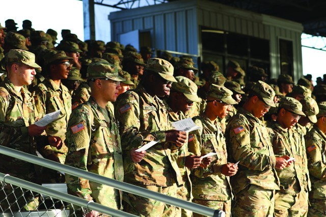 Trainees sing along with one of the musical performance during Fort Jackson's Easter Sunrise Service April 1.