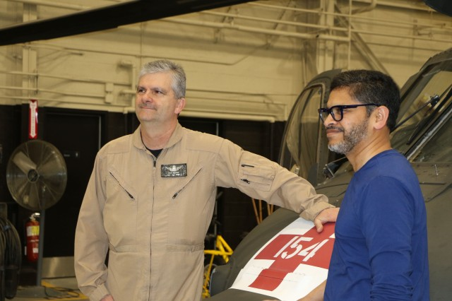 David A. Mattox, Aviation Support Facility Knox Supervisor and Dr. Mahesh Daas, dean of the School of Architecture & Design, with a HH-60M Black Hawk helicopter during the tour of Fort Knox.
