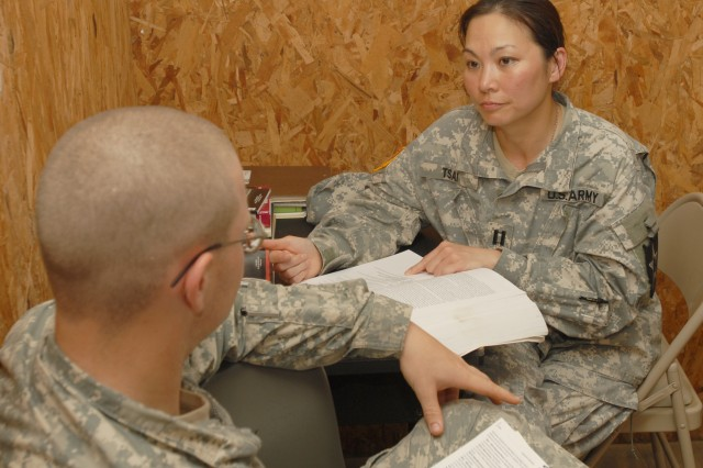 Capt. Michelle Tsai, behavioral health officer for the 4th Brigade, 2nd Infantry Division, reviews medical information during pre-deployment training at the Joint Readiness Training Center at Fort Polk, La.