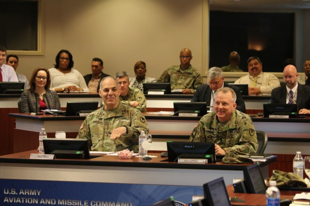 Participants in the quarterly update with the Aviation and Missile Command leadership team include Army Materiel Command's Commander Gen. Gus Perna, left, and AMCOM Commander Maj. Gen. Doug Gabram.