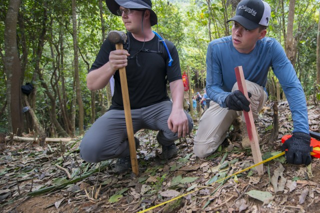 Sgt. Matthew Haase, right, and Air Force Staff Sgt. Tyler Trusty help line up a grid at a recovery site March 17, 2018, in Quang Ngai province, Vietnam, where an American pilot crashed during the Vietnam War. Members of a recovery team assigned to the Defense POW/MIA Accounting Agency lived in tents for 30 days and hiked up to the site every day as part of the mission.