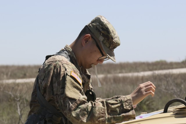 FORT HOOD, Texas--Sgt Jaemin Park, finance NCOIC, 15th Financial Management Support Company, Special Troop Battalion, 1st Cavalry Division Sustainment Brigade plot his points for the land navigation course during the NCO and Soldier of the Year competition. Parks was identified as the winner of the competition and will go on to represent 1CDSB in the division level Best Warrior Competition April 23-27.