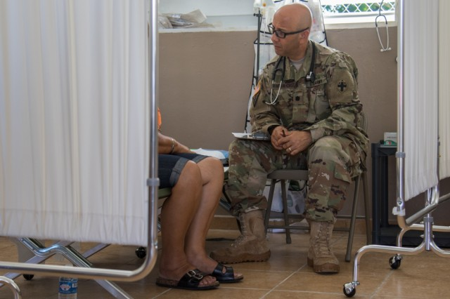 A patient speaks with Army Lt. Col. Gustavo Rivera-Cruz, a psychiatrist with the 335th Area Support Medical Company, U.S. Army Reserve in Utuado, Puerto Rico on Nov. 28, 2017. The Army has expanded behavioral health care for its Soldiers and Army Families to increase readiness.