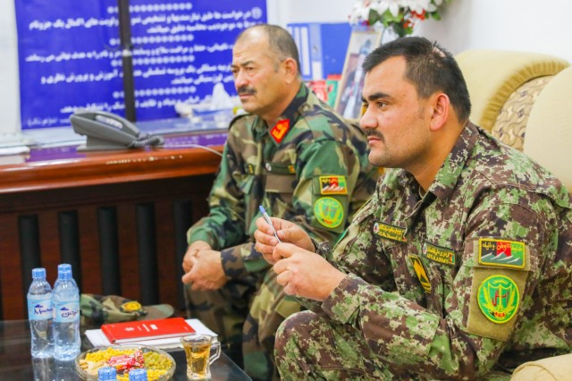 Sgt. Maj. Abdul Rawof Klafgani, near, logistics sergeant major, 205th Afghan National Army Corps, and Lt. Col. Mohammad Yunas, logistics director, 205th ANA Corps, listen to their U.S. counterpart, March 27, 2018, during a meeting in Kandahar, Afghanistan. Soldiers from Train, Advise and Assist Command-South, composed of Soldiers from the 40th Infantry Division, California National Guard, and 2nd Infantry Brigade Combat Team, 4th Infantry Division, train and advice Afghan forces and assist with counterterrorism operations. (U.S. Army photo by Staff Sgt. Neysa Canfield/TAAC-South Public Affairs)