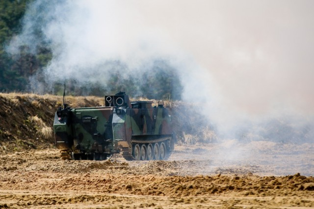 A M58 Wolf is remotely controlled to release a cloud of smoke during a multinational joint equipment U.S. military training exercise at Grafenwoehr Training Area, Germany, April 2, 2018 in preparation for a Robotic Complex Breach Concept demonstration.