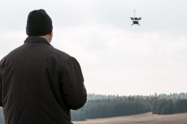 Byron Russell, an operator for an unmanned aerial system called the Instant Eye, flies the system and demonstrates its capability during a multinational joint equipment training brief April 2, 2018 in Grafenwoehr, Germany.