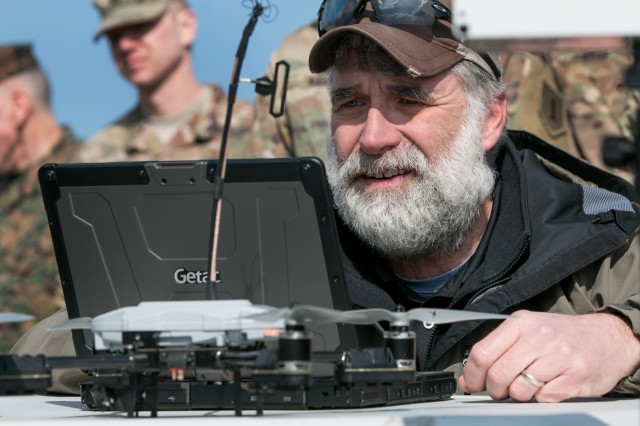 Mike Mackiewicz, an operator for an unmanned aerial system called the Instant Eye, readies software for the system during a multinational joint equipment training brief on April 2, 2018 in Grafenwoehr, Germany.