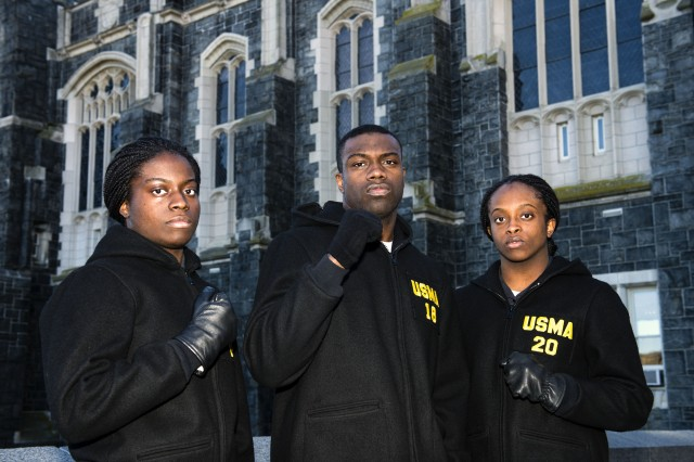 "Egbezien ""E.B."" Obiomon (center), hopes to win another National Collegiate Boxing Association national title in the 185-pound weight division. He has passed on his boxing knowledge to his sisters, Ejakhianaghe (left) and Ebakoliane (right). Ejakhianaghe won the 2017 national title in the 165-pound class for the women's team, while Ebakoliane was the runner-up in the 156-pound class."
