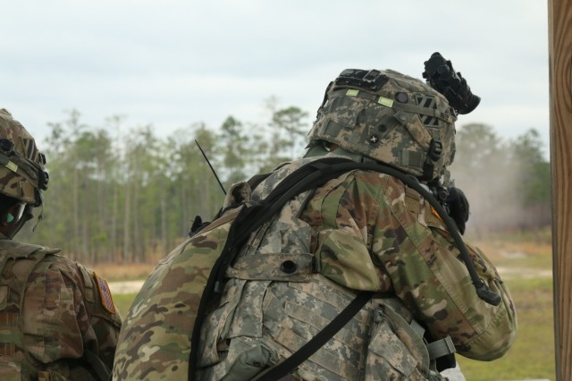 Spc. Charon White, movement specialist with the 258th Movement Control Team, 3rd Sustainment Brigade Special Troops Battalion, 3rd Infantry Division, shoots from a tower during a base-defense live fire exercises at Fort Stewart, Georgia, April 4, 2018. Soldiers of the 258th Movement Control Team, the 90th Human Resources Company and the 274th Movement Control Team participated in the exercise to gain knowledge and experience in the concept of unit area defense. (U.S. Army photo by Spc. Noelle E. Wiehe, 50th Public Affairs Detachment, 3rd Infantry Division).