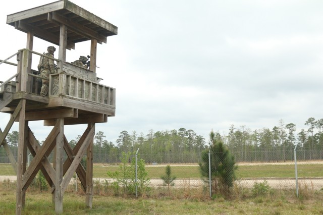 Soldiers with the 258th Movement Control Team, 3rd Sustainment Brigade Special Troops Battalion, 3rd Infantry Division, shoot from a tower during a base-defense live fire exercises at Fort Stewart, Georgia, April 4, 2018. Soldiers of the 258th Movement Control Team, the 90th Human Resources Company; and the 274th Movement Control Team participated in the exercise to gain knowledge and experience in the concept of unit area defense. (U.S. Army photo by Spc. Noelle E. Wiehe, 50th Public Affairs Detachment, 3rd Infantry Division).