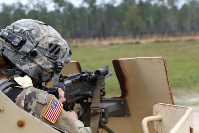 Pfc. Jennifer Flores, 258th Movement Control Team, 3rd Sustainment Brigade Special Troops Battalion, 3rd Infantry Division, shoots her M249, light machine gun mounted on top of an armored high-mobility, wheeled vehicle during a base-defense live fire exercises at Fort Stewart, Georgia, April 4, 2018. Soldiers of the 258th Movement Control Team, the 90th Human Resources Company, and the 274th Movement Control Team participated in the exercise to gain knowledge and experience in the concept of unit area defense. (U.S. Army photo by Sgt. Joseph Truckley, 50th Public Affairs Detachment, 3rd Infantry Division)