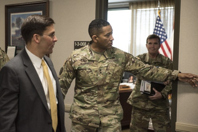 Dr. Mark T. Esper, the 23rd Secretary of the Army, discusses talent management with Maj. Gen. Jason T. Evans, U.S. Army Human Resources Command commanding general, at the Lt. Gen. Timothy J. Maude complex on Fort Knox, Ky. April 6, 2018. While there Esper was given a firsthand look at the officer assignment process from start to finish through the Assignment Interactive Module 2.0, or AIM 2. To meet the challenges of the future, the Army is moving from a plug and play type system where Soldiers are merely allocated and distributed based upon the needs of the Army to one where Soldiers and civilians are more deliberately managed and reassigned based upon their special skill sets.(U.S. Army photo by Master Sgt. Brian Hamilton/ released)