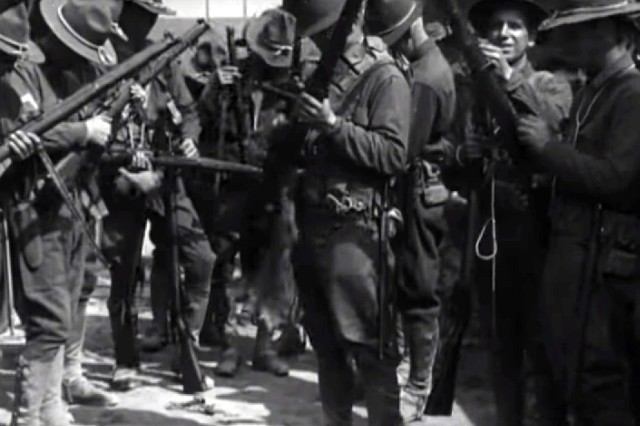 In this video from a 1918 silent movie on the National Archives website, Soldiers of the 28th Division's 1st Battalion 112th Infantry Regiment get acquainted with the British Lee-Enfield rifle in May 1918 after turning in their American-issued Springfield rifles. The Soldiers of the 77th Division, most of whom were draftees from New York City, also swapped their American for British rifles as they began training with British Army instructors. ( U.S. Army Signal Corps)