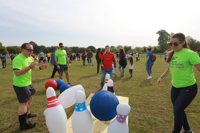 FORT BENNING, Ga. (April 6, 2018) -- Lawn bowling took place at Stewart-Smith Field during the Tri-Community Field Day. Hundreds of young athletes and volunteers from Fort Benning and Columbus, Georgia, Phenix City, Alabama, and surrounding communities gathered at the Fort Benning main post April 6 to take part in the Tri-Community Field Day. The annual event, now in its fifth year, celebrates exceptional children of Fort Benning and the surrounding school districts (Chattahoochee County, Fort Benning, Harris County, Muscogee County, Phenix City, and Russell County) and homeschooled children. (U.S. Army photo by Markeith Horace, Maneuver Center of Excellence, Fort Benning Public Affairs)