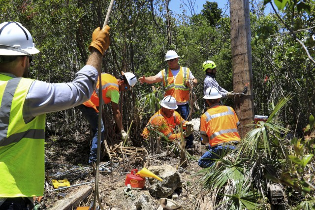 U.S. Army Corps of Engineers Task Force Power Restoration contractors complete work on a transmission line in the Guanica State Forest, Puerto Rico, April 6. The line connects the Costa Sur Power Plant in Ponce to Mayaguez. Mayaguez is the eighth-largest municipality in Puerto Rico. The repairs stabilized the system for the region.