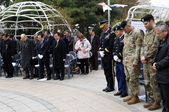 Attendees of the 54th Memorial Ceremony for Gen. Douglas MacArthur hold a moment of silence at Freedom Park, Incheon, South Korea, April 6. The ceremony was hosted by the Association of Korea - U.S.A Friendship Alliance to honor MacArthur's devotion to freedom and democracy.